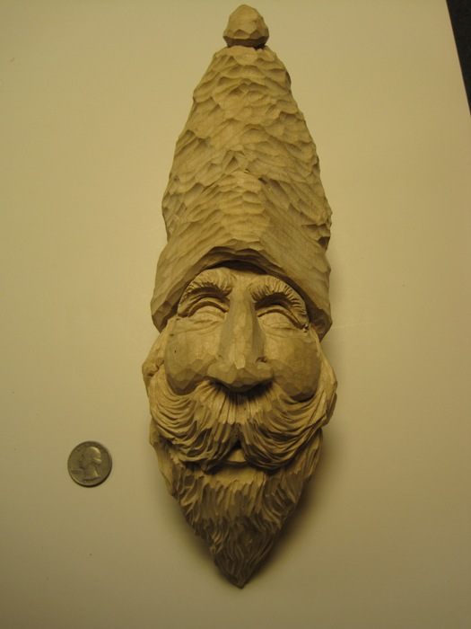 Wood carving old fashioned face tom wolfe style